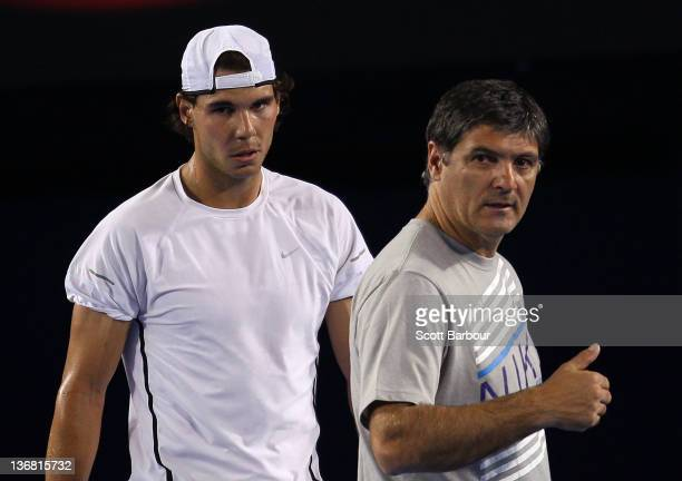 Rafael Nadal of Spain and Toni Nadal his uncle and coach talk during practice ahead of the 2012 Australian Open at Rod Laver Arena on January 12 2012...