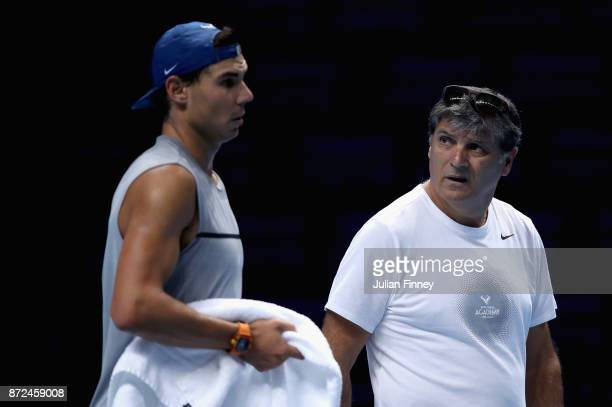 Rafael Nadal of Spain and Toni Nadal speak during a training session prior to the Nitto ATP World Tour Finals at O2 Arena on November 10 2017 in...