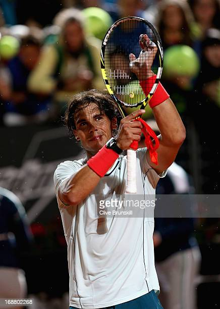Rafael Nadal of Spain applauds the crowd after his straight sets victory against Fabio Fognini of Italy in their second round match during day four...