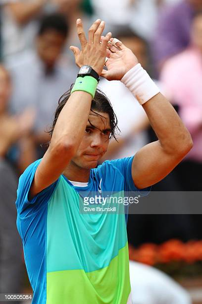Rafael Nadal of Spain applauds the crowd as he celebrates victory in the men's singles first round match between Rafael Nadal of Spain and Gianni...