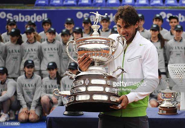 Rafael Nadal of Spain bites the trophy after beating David Ferrer during the final match on day seven of the ATP 500 World Tour Barcelona Open Banco...