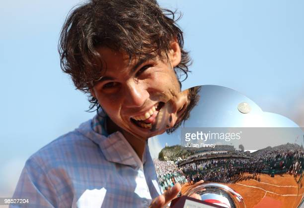 Rafael Nadal of Spain bites the trophy after defeating Fernando Verdasco of Spain in the final during day Seven of the ATP Masters Series at the...