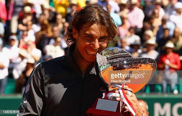 Rafael Nadal of Spain bites the trophy after his straight sets victory against Novak Djokovic of Serbia in the final during day eight of the ATP...