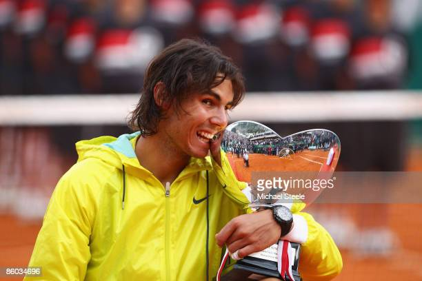 Rafael Nadal of Spain bites the winners trophy after his 632661 victory in the final match against Novak Djokovic of Serbia during day seven of the...