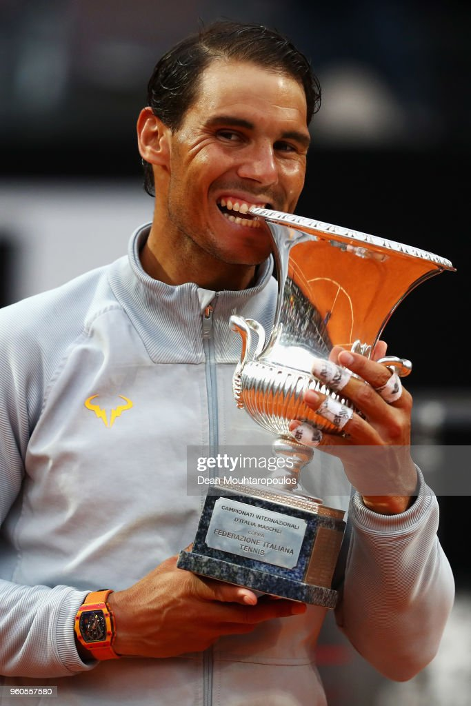 Rafael Nadal of Spain celebrate by biting the trophy after victory in his Mens Final match against Alexander Zverev of Germany during day 8 of the Internazionali BNL d'Italia 2018 tennis at Foro Italico on May 20, 2018 in Rome, Italy.