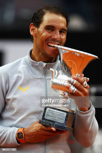 Rafael Nadal of Spain celebrate by biting the trophy after victory in his Mens Final match against Alexander Zverev of Germany during day 8 of the...