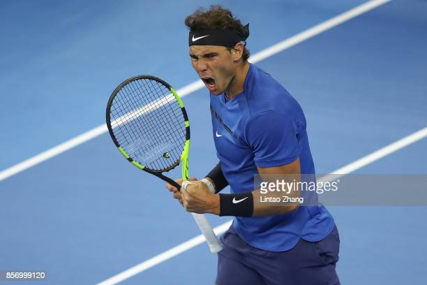 Rafael Nadal of Spain celebrates a point against Lucas Pouille of France during the Men's singles first round on day four of 2017 China Open at the...