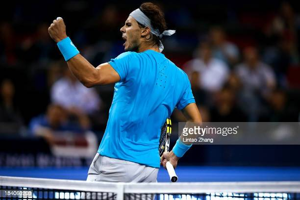 Rafael Nadal of Spain celebrates a point against Stanislas Wawrinka of Switzerland during day five of the Shanghai Rolex Masters at the Qi Zhong...