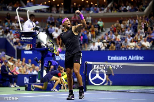 Rafael Nadal of Spain celebrates a point during the fifth set of his Men's Singles final match against Daniil Medvedev of Russia on day fourteen of...