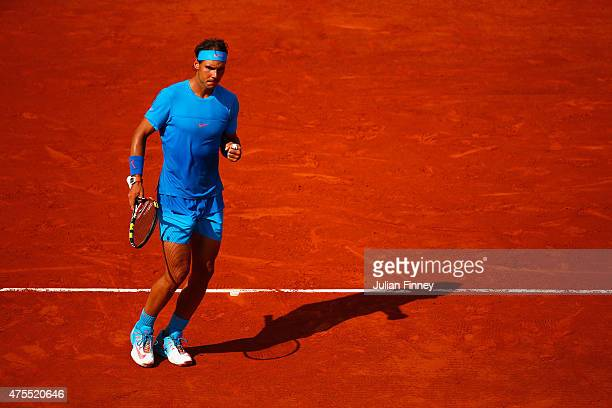 Rafael Nadal of Spain celebrates a point in his Men's Singles match against Jack Sock of the United States on day nine of the 2015 French Open at...