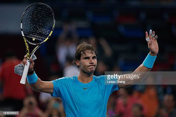 Rafael Nadal of Spain celebrates after defeating Alexandr Dolgopolov of Ukraine during day three of the Shanghai Rolex Masters at the Qi Zhong Tennis...