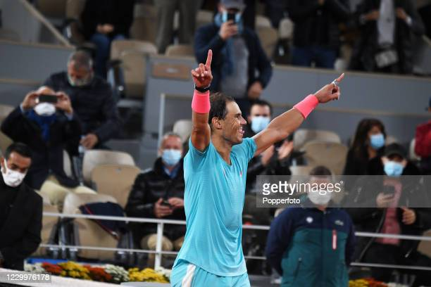 Rafael Nadal of Spain celebrates after defeating Novak Djokovic of Serbia during the men's singles final on day fifteen of the 2020 French Open at...