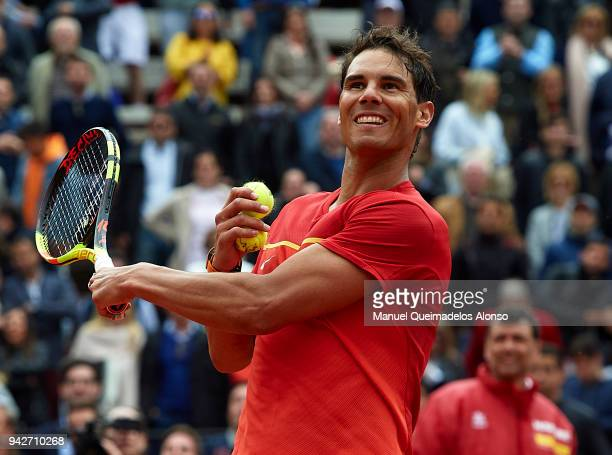 Rafael Nadal of Spain celebrates after defeating Philipp Kohlschreiber of Germany during day one of the Davis Cup World Group Quarter Final match...
