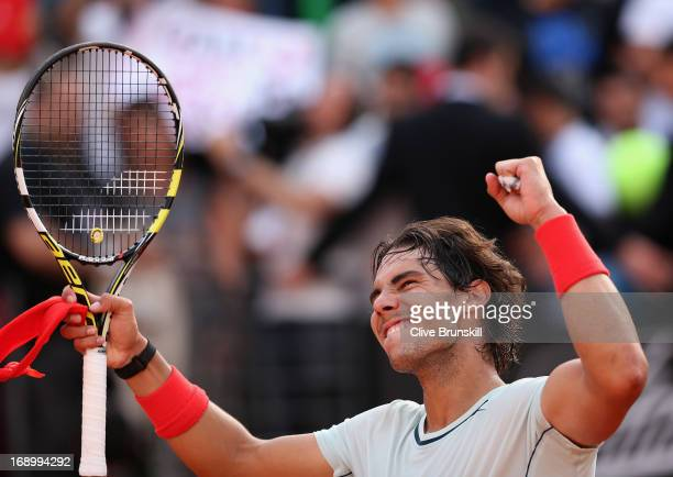 Rafael Nadal of Spain celebrates after his straight sets victory against Tomas Berdych of the Czech Republic in their semi final match during day...