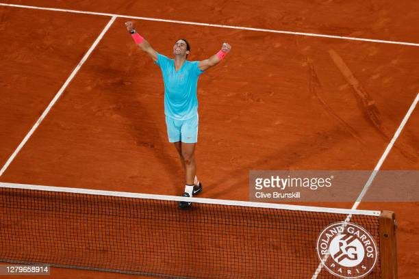 Rafael Nadal of Spain celebrates after winning championship point, and securing his 13th French Open title during his Men's Singles Final against...