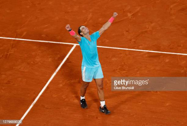 Rafael Nadal of Spain celebrates after winning championship point during his Men's Singles Final against Novak Djokovic of Serbia on day fifteen of...