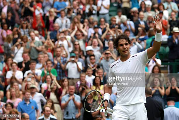 Rafael Nadal of Spain celebrates after winning his Gentlemen's Singles first round match against Thomaz Bellucci of Brazil on day two of the...