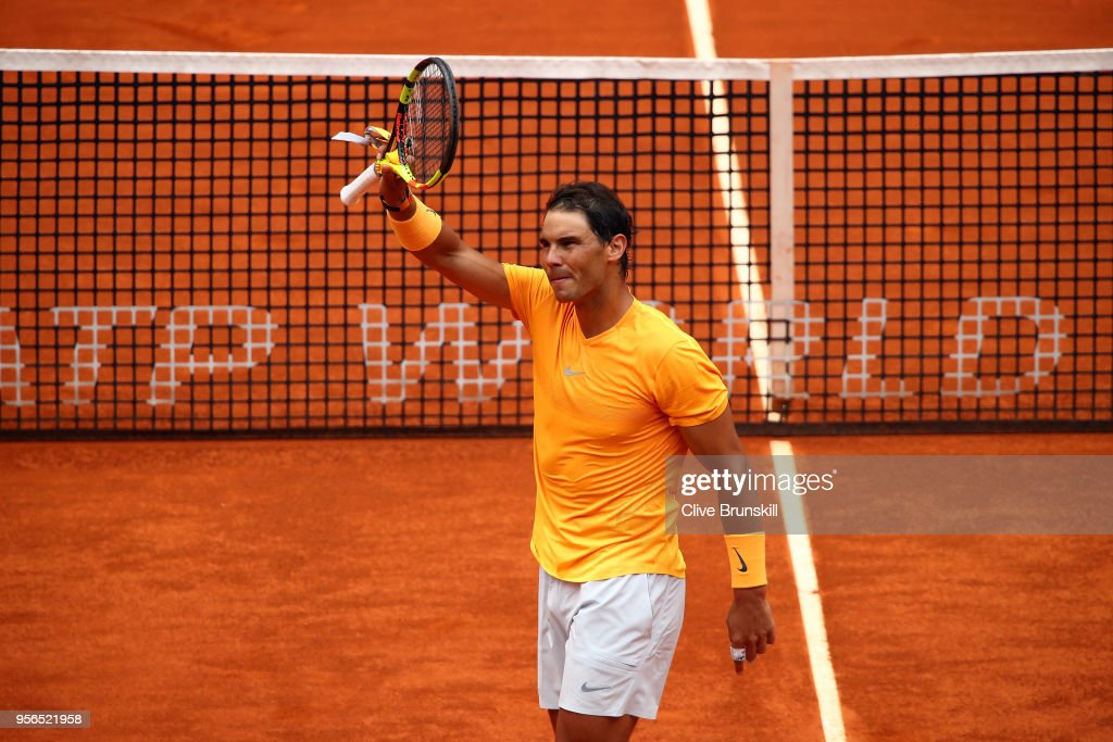 Rafael Nadal of Spain celebrates beating Gael Monfils of France during their second round match on day five of the Mutua Madrid Open at La Caja Magica on May 9, 2018 in Madrid, Spain.