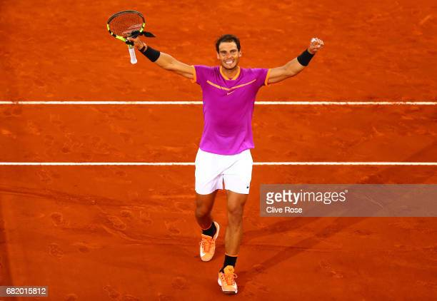 Rafael Nadal of Spain celebrates beating Nick Kyrgios of Australia on day six of the Mutua Madrid Open tennis at La Caja Magica on May 11 2017 in...