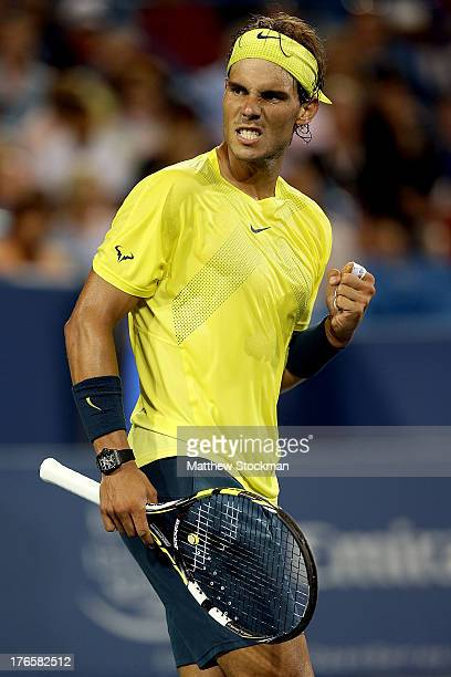 Rafael Nadal of Spain celebrates breaking Grigor Dimitrov of Bulgaria in the third set during the Western Southern Open on August 15 2013 at Lindner...
