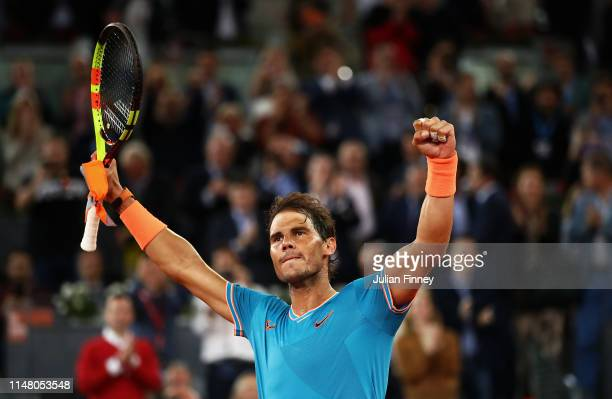 Rafael Nadal of Spain celebrates defeating Frances Tiafoe of USA during day six of the Mutua Madrid Open at La Caja Magica on May 09 2019 in Madrid...