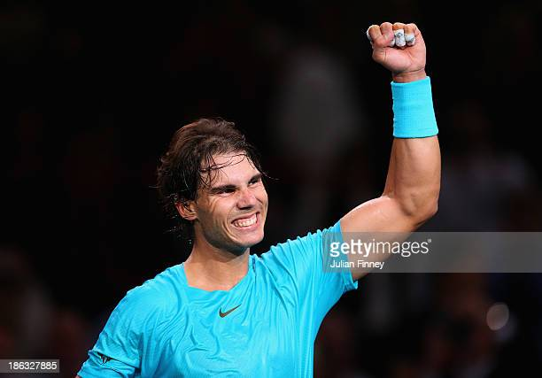 Rafael Nadal of Spain celebrates defeating Marcel Granollers of Spain during day three of the BNP Paribas Masters at Palais Omnisports de Bercy on...