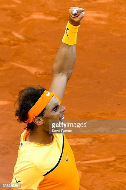 Rafael Nadal of Spain celebrates defeating Philipp Kohlschreiber of Germany during day six of the Barcelona Open Banc Sabadell at the Real Club de...
