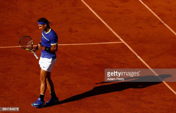 Rafael Nadal of Spain celebrates during the mens singles semifinal match against Dominic Thiem of Austria on day thirteen of the 2017 French Open at...