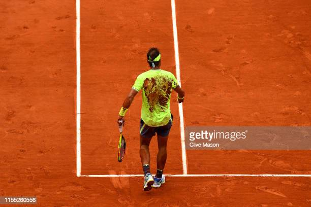 Rafael Nadal of Spain celebrates following the mens singles final against Dominic Thiem of Austria during Day fifteen of the 2019 French Open at...
