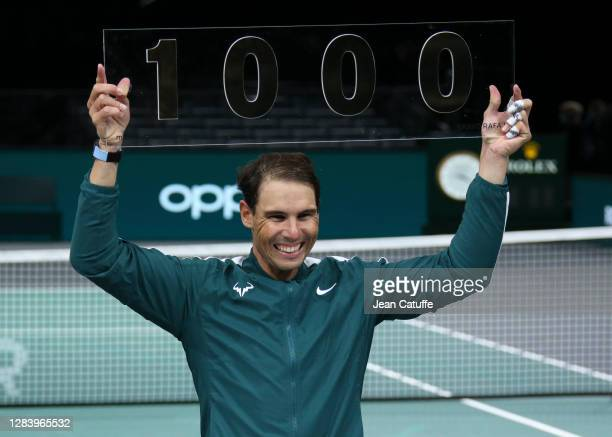 Rafael Nadal of Spain celebrates his 1,000th victory on Tour after beating Feliciano Lopez of Spain during day 3 of the Rolex Paris Masters, an ATP...