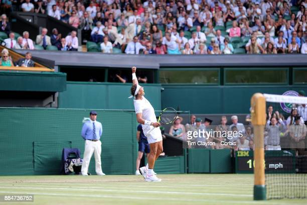 Rafael Nadal of Spain celebrates his victory against Karen Khachanov of Russia in the Gentlemen's Singles competition on Centre Court during the...
