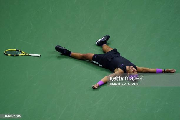 TOPSHOT Rafael Nadal of Spain celebrates his victory over Daniil Medvedev of Russia during the men's Singles Finals match at the 2019 US Open at the...