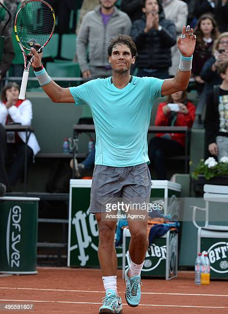Rafael Nadal of Spain celebrates his victory over his compatriot David Ferrer during their quarter final match of the French Open tennis tournament...