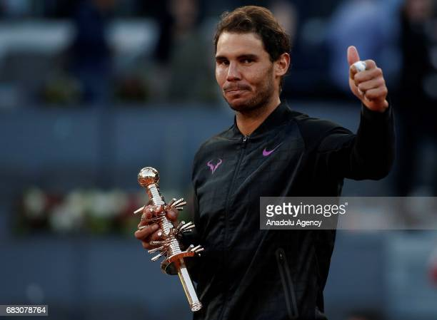 Rafael Nadal of Spain celebrates his victory with his trophy after his match against Dominic Thiem of Australia during the ATP Masters 1000 Open...