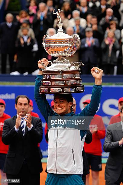 Rafael Nadal of Spain celebrates holds the trophy after winning his final match againts Nicolas Almagro of Spain during day seven of the 2013...