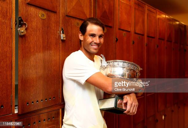 Rafael Nadal of Spain celebrates in the locker room with the winners trophy following the mens singles final against Dominic Thiem of Austria during...