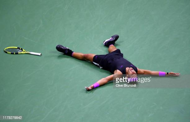 Rafael Nadal of Spain celebrates match point after winning his Men's Singles final match against Daniil Medvedev of Russia on day fourteen of the...