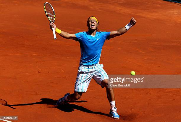 Rafael Nadal of Spain celebrates match point against Nicolas Almagro of Spain in their semi final match during the Mutua Madrilena Madrid Open tennis...
