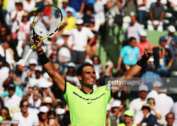 Rafael Nadal of Spain celebrates match point against Nicolas Mahut of France during Day 9 of the Miami Open at Crandon Park Tennis Center on March 28...