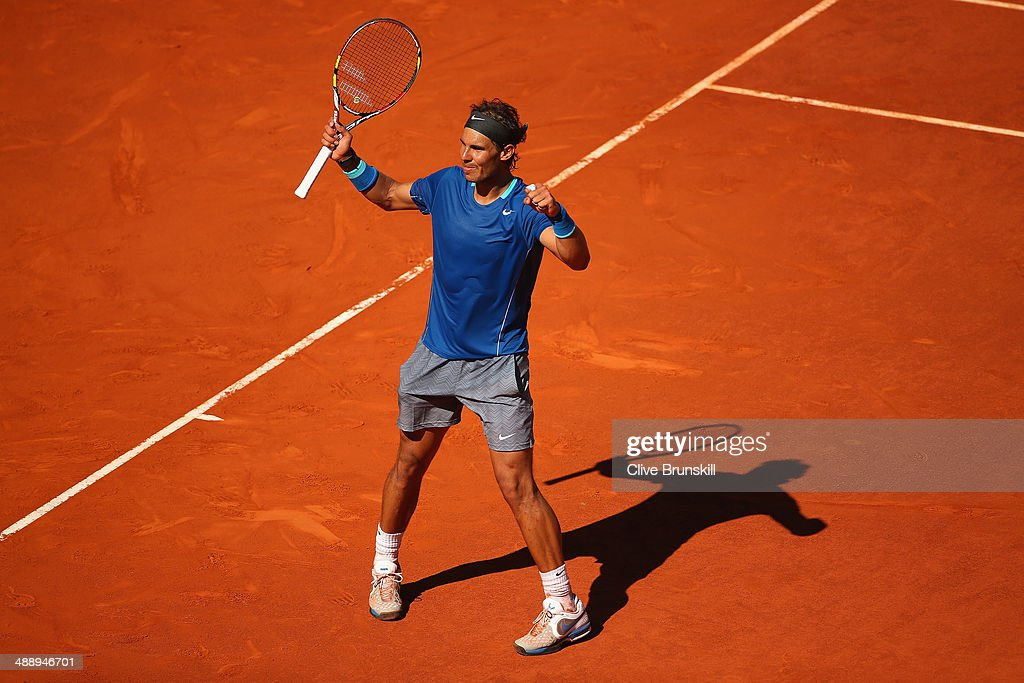 Rafael Nadal of Spain celebrates match point against Tomas Berdych of the Czech Republic in their quarter final match during day seven of the Mutua Madrid Open tennis tournament at the Caja Magica on May 9, 2014 in Madrid, Spain.