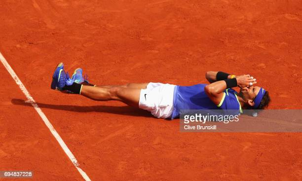 Rafael Nadal of Spain celebrates match point and victory during the men's singles final against Stan Wawrinka of Switzerland on day fifteen of the...