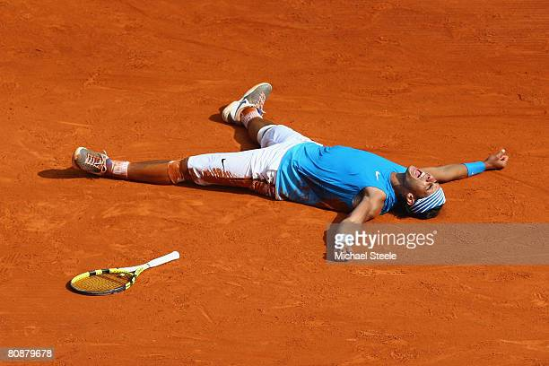 Rafael Nadal of Spain celebrates match point during his 7575 victory in the singles final match against Roger Federer of Switzerland on day nine of...