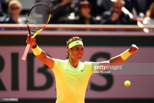 Rafael Nadal of Spain celebrates match point during his mens singles semi-final match against Roger Federer of Switzerland during Day thirteen of the...