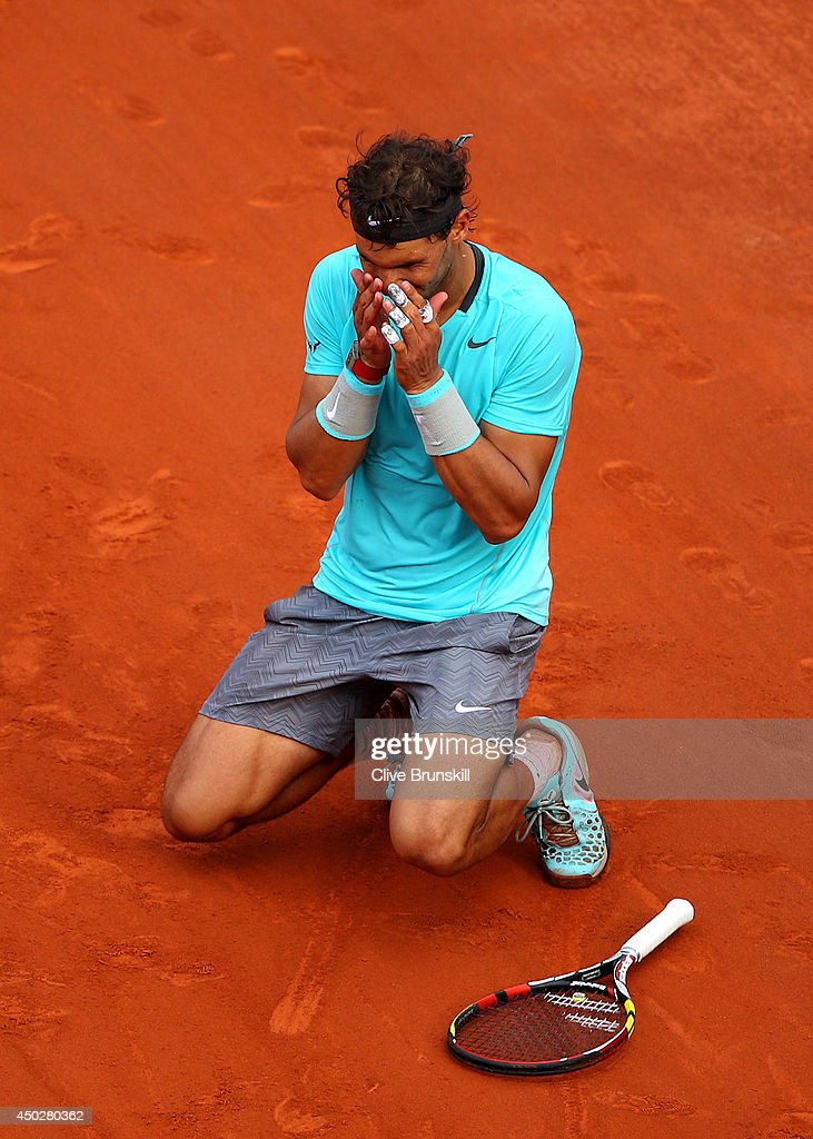 Rafael Nadal of Spain celebrates match point during his men's singles final match against Novak Djokovic of Serbia on day fifteen of the French Open at Roland Garros on June 8, 2014 in Paris, France.