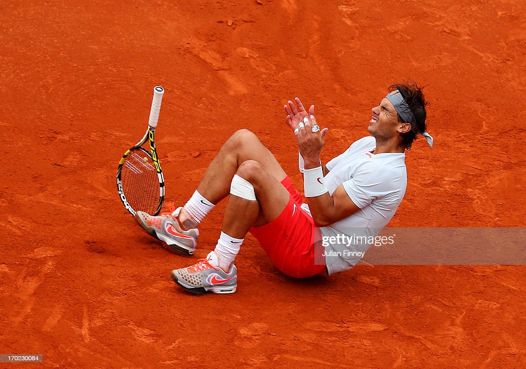 Rafael Nadal of Spain celebrates match point during the Men's Singles final match against David Ferrer of Spain on day fifteen of the French Open at Roland Garros on June 9, 2013 in Paris, France.