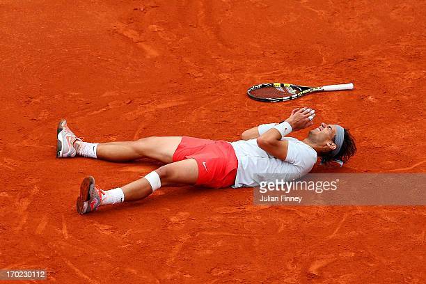 Rafael Nadal of Spain celebrates match point during the Men's Singles final match against David Ferrer of Spain on day fifteen of the French Open at...