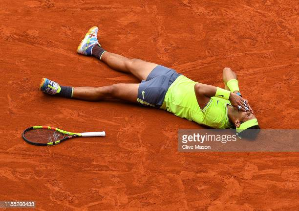 Rafael Nadal of Spain celebrates match point following the mens singles final against Dominic Thiem of Austria during Day fifteen of the 2019 French...