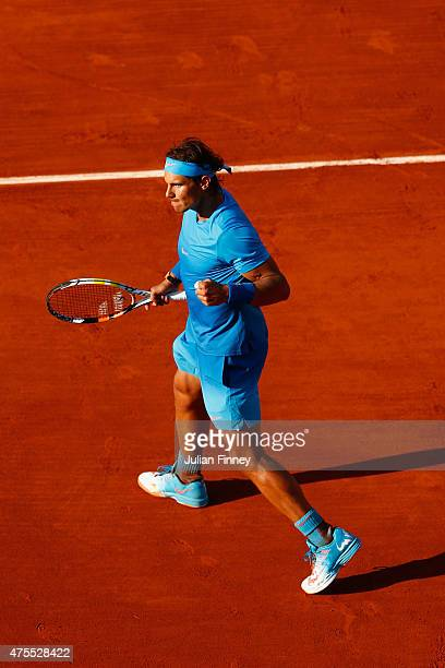 Rafael Nadal of Spain celebrates match point in his Men's Singles match against Jack Sock of the United States on day nine of the 2015 French Open at...