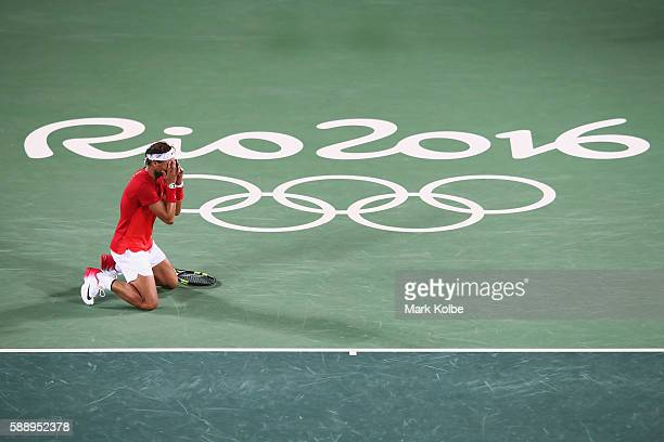 Rafael Nadal of Spain celebrates match point in the Men's Doubles Gold medal match with Marc Lopez of Spain against Horia Tecau and Florin Mergea of...