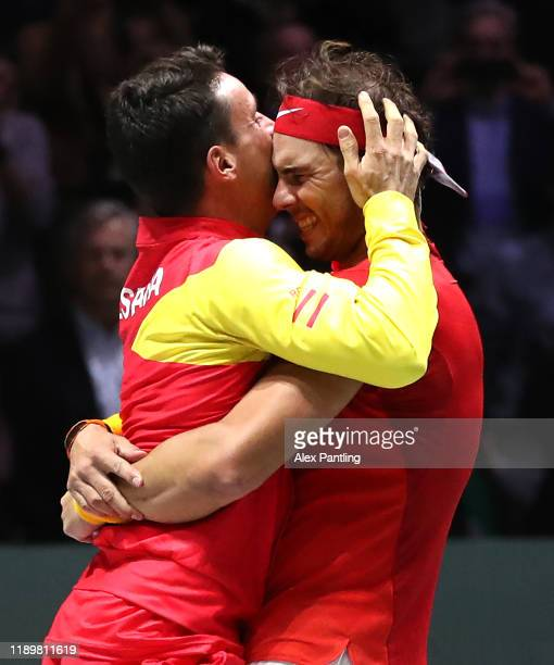 Rafael Nadal of Spain celebrates match point with Roberto Bautista Agut in his singles match against Denis Shapovalov of Canada in the Final between...